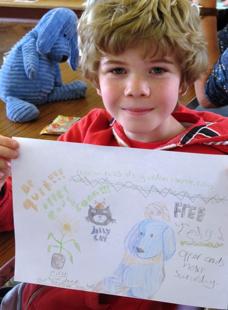 Story Factory child with ad for Russells Garden Centre