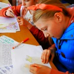Children drawing at Story Factory Chichester Photo By K Lassetter