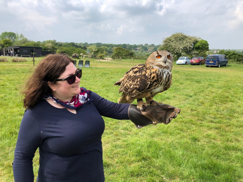Katy holding an eagle owl at a Hawking About Owl Encounter