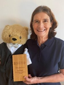 Complementary Therapist Mary Atkinson with Emmanuel the Bear and the FHT Award