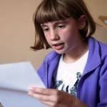 Child reading out her story at Story Factory Chichester Photo by Rachel Poulton