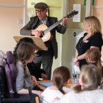 Mike Fry teaching the children their story song at Story Factory Chichester Photo by Rachel PoultonRachel