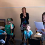 Child reading out her story with Becky Edwards at Story Factory Chichester Photo by Rachel Poulton