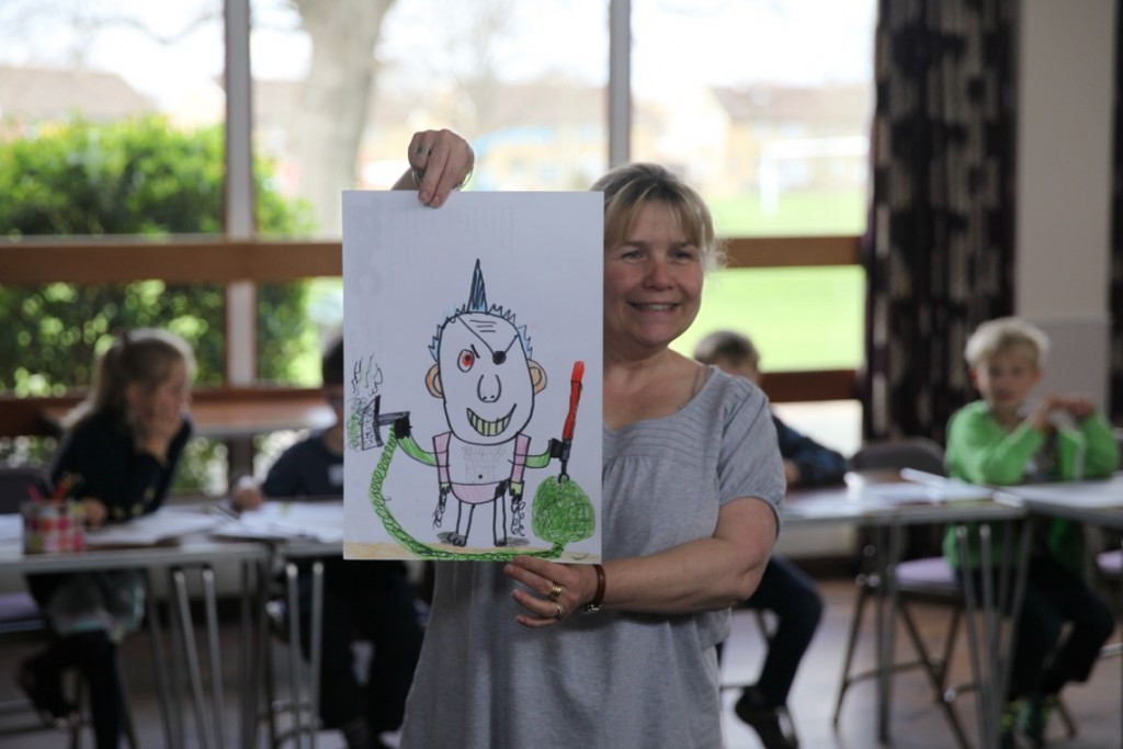 Vicky Edwards shows off Story Factory child's art